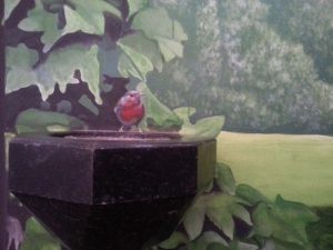Trompe l'oeil: roodborstje met (echt) wijwaterbakje